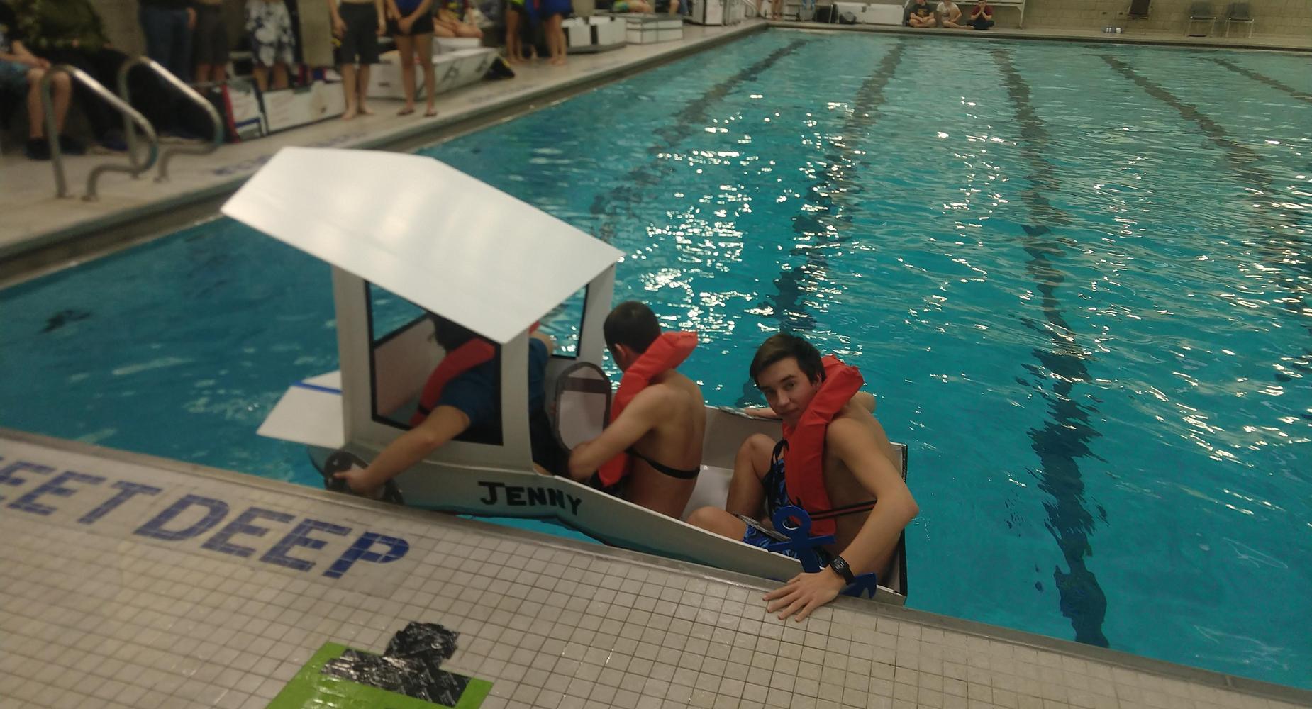 Students in boat in pool
