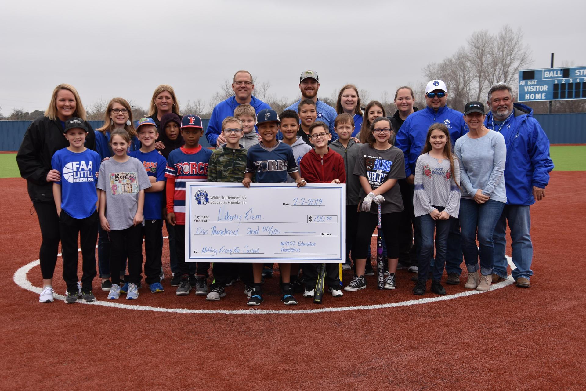 The Foundation awarded $300 to schools during the Spring Sports Rally and Opening Day Ceremony on Feb. 2.