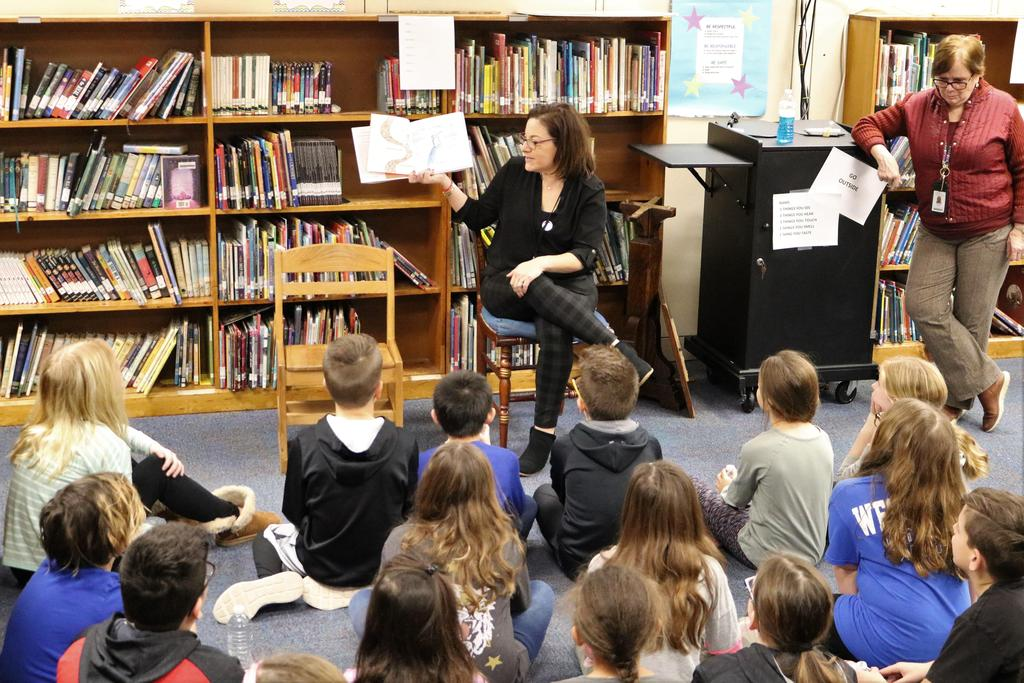 """Photo of McKinley librarian reading """"I am Human"""" to 4th graders."""