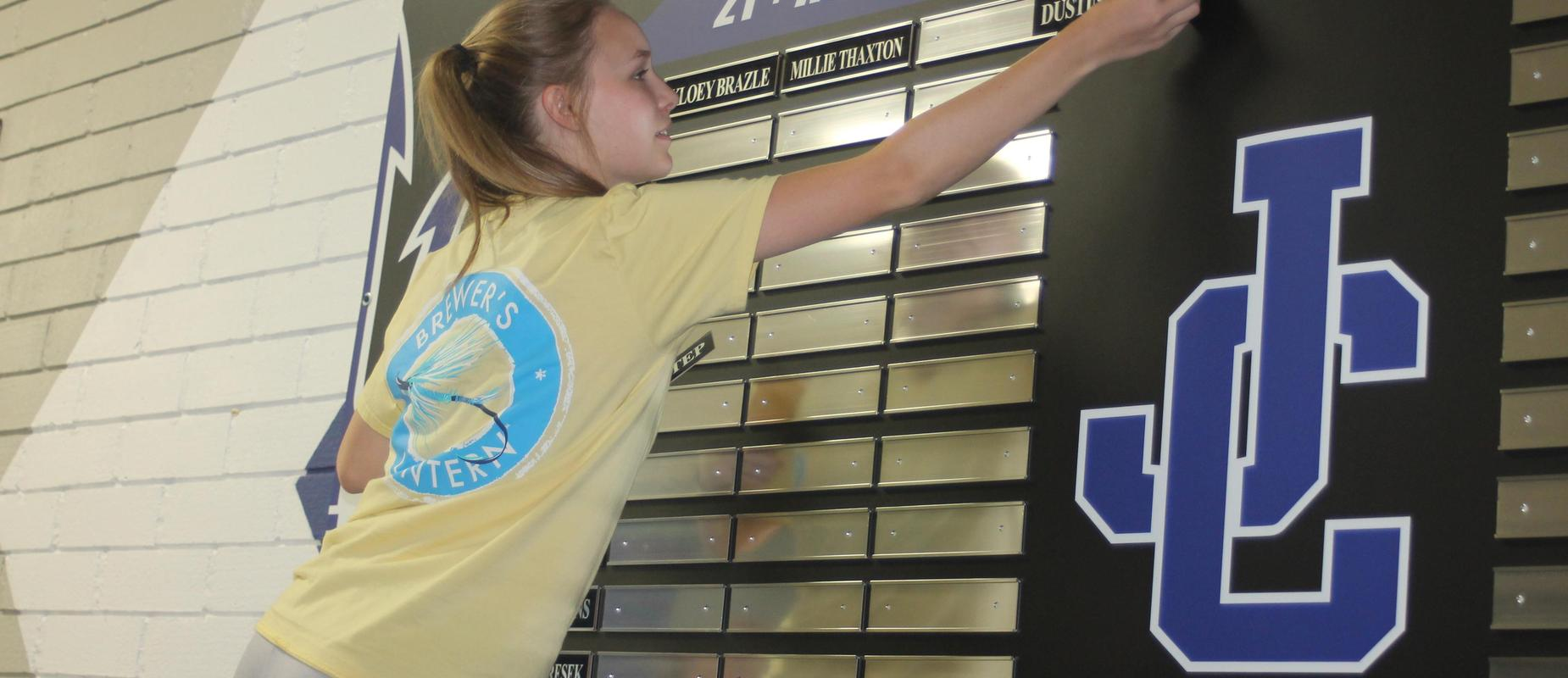 Student hangs new awards for excellence in ACT