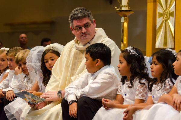 Fr. David Loftus and 1st Communicants