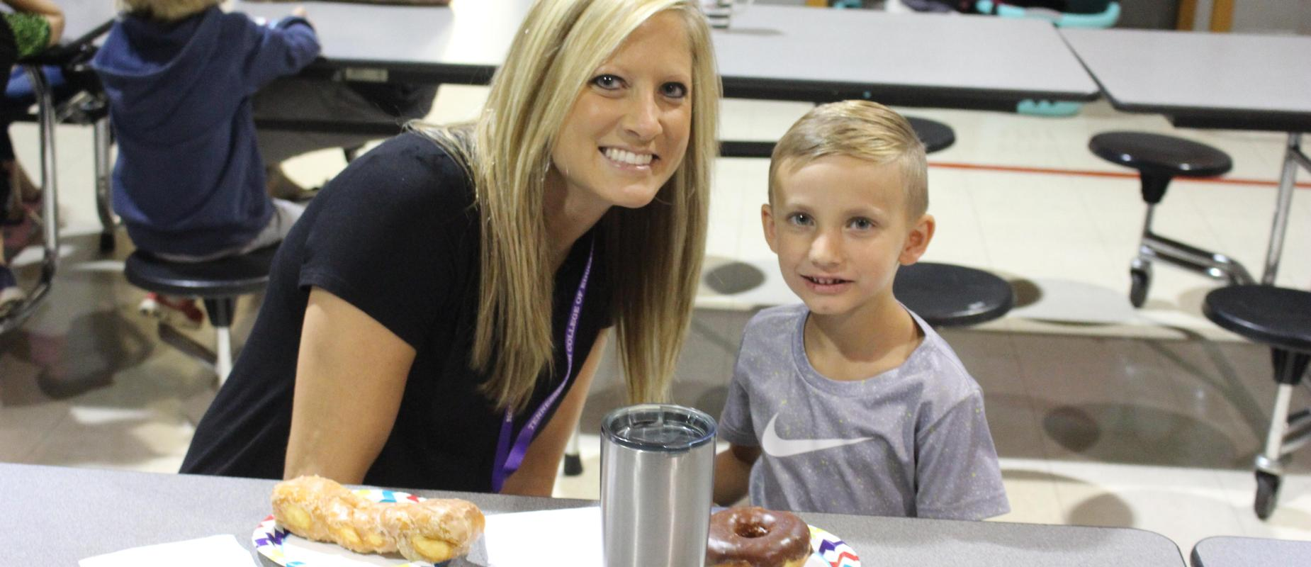 parent having donuts with student