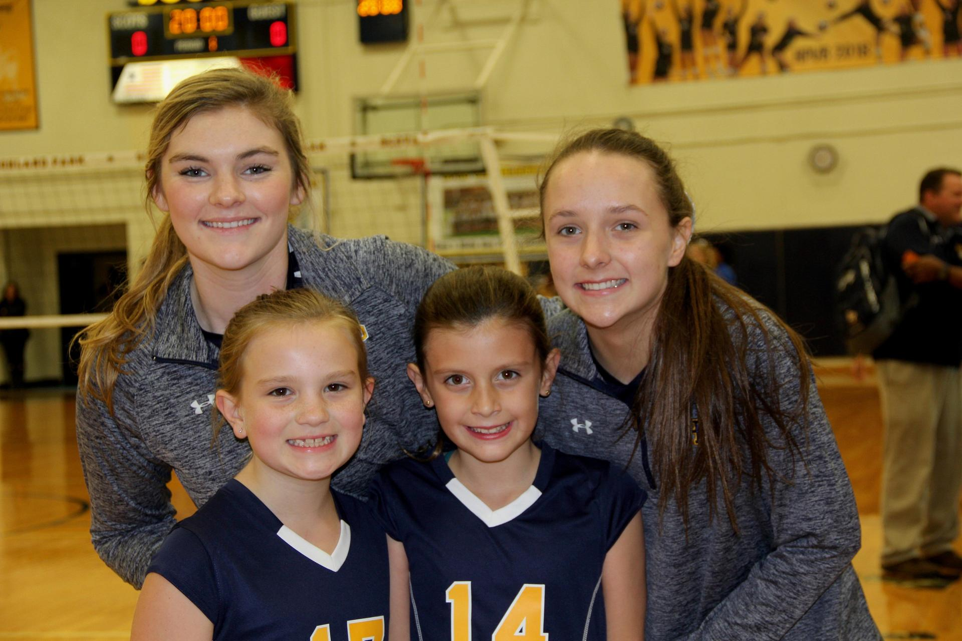 Highland Park Volleyball captains Britton Daugbjerg and Anna Holder with honorary captains Emma Laszewski and Carol Adams