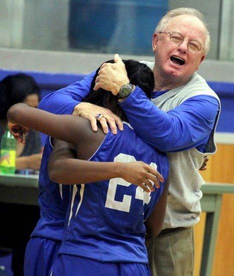 Southeast High School basketball oach congratulating a player.