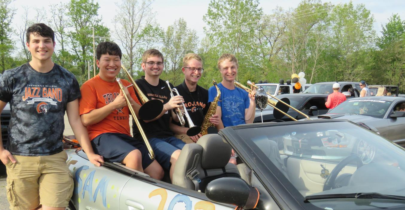 Four senior band members get ready to play the school song during the senior cruise.