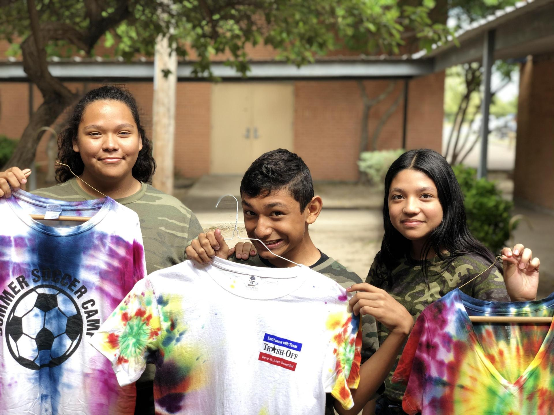 Students pose with shirts.