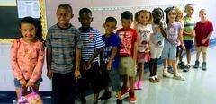 Kindergarten class lined up in hallway