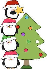 Christmas tree with stack of penguins putting star on top