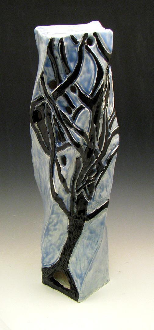tall blue lantern with black tree image