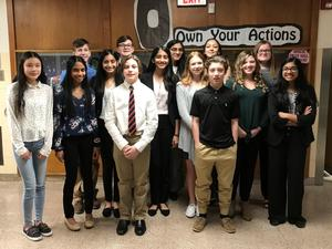 14 Snyder middle school students, dressed to impress, pose for a picture at the PJAS Regional Competition at Snyder Middle School