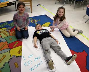 Photo of Tamaques 1st graders working on 100th Day of School activity.