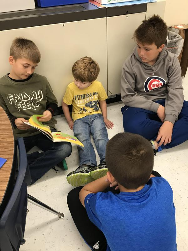 Older students read to PreK students