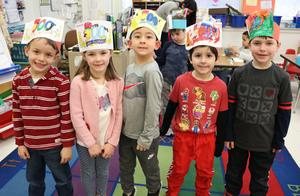 Lincoln School kindergartners pose for a picture wearing 100th Day of School hats and preparing for Valentine's Day activities.