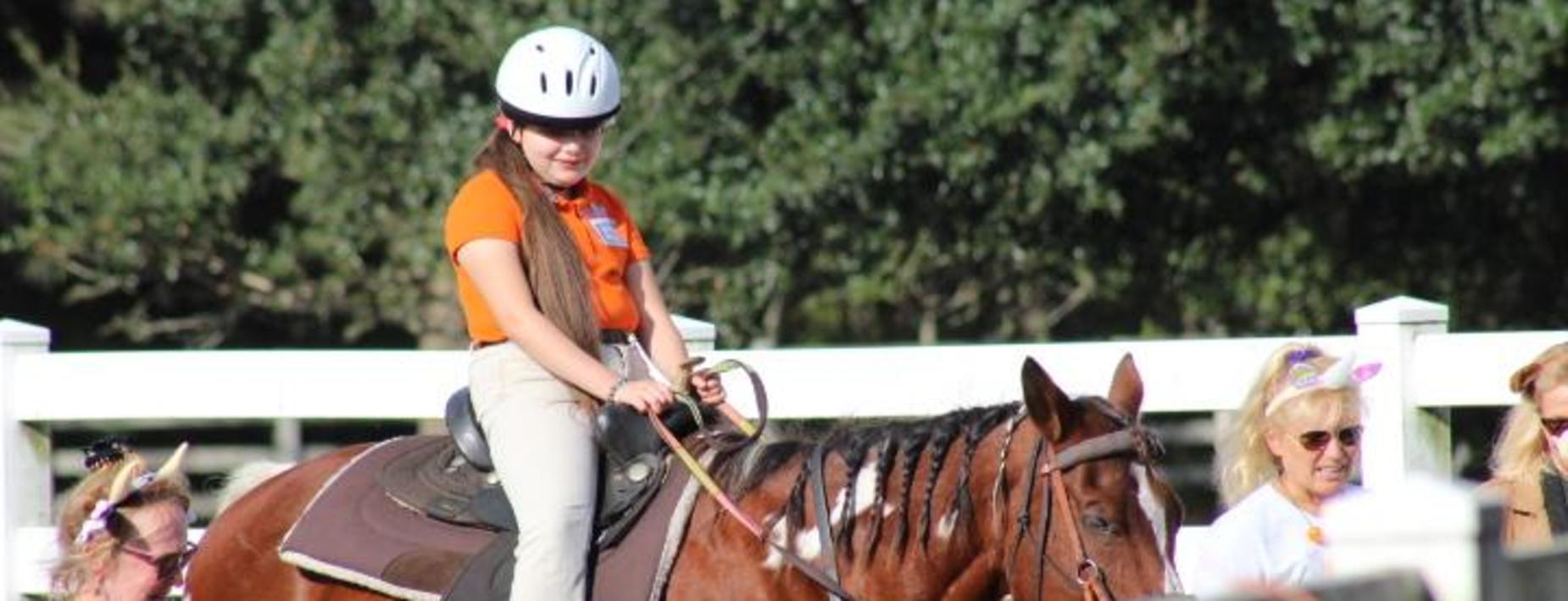 Girl on a horse at Heroes on Horseback