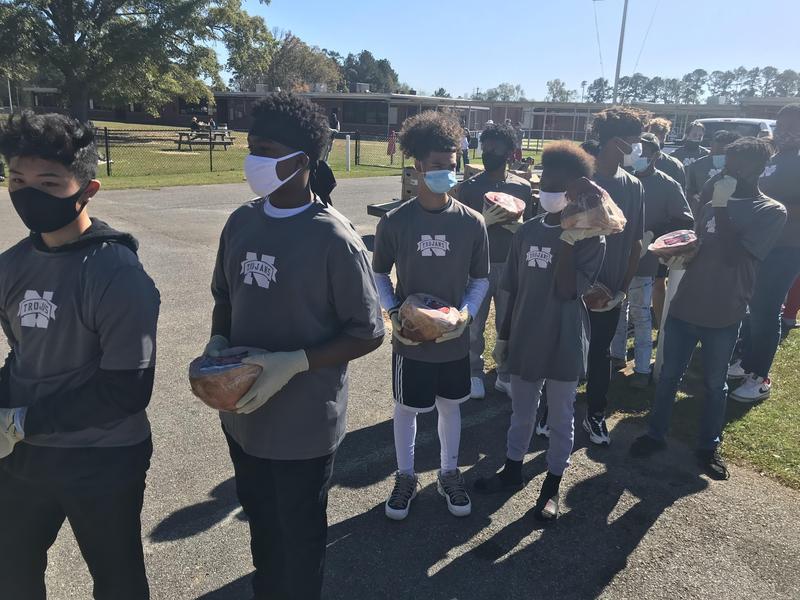 NEHS Football: Free Thanksgiving Ham Distribution Day