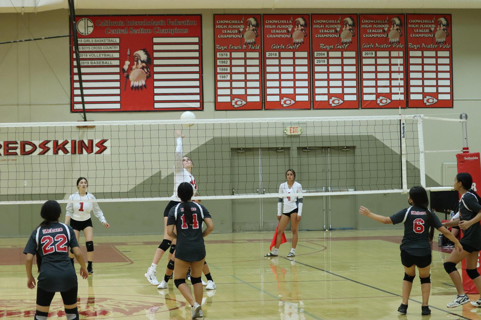 JV Girls Playing Volleyball Against McLane
