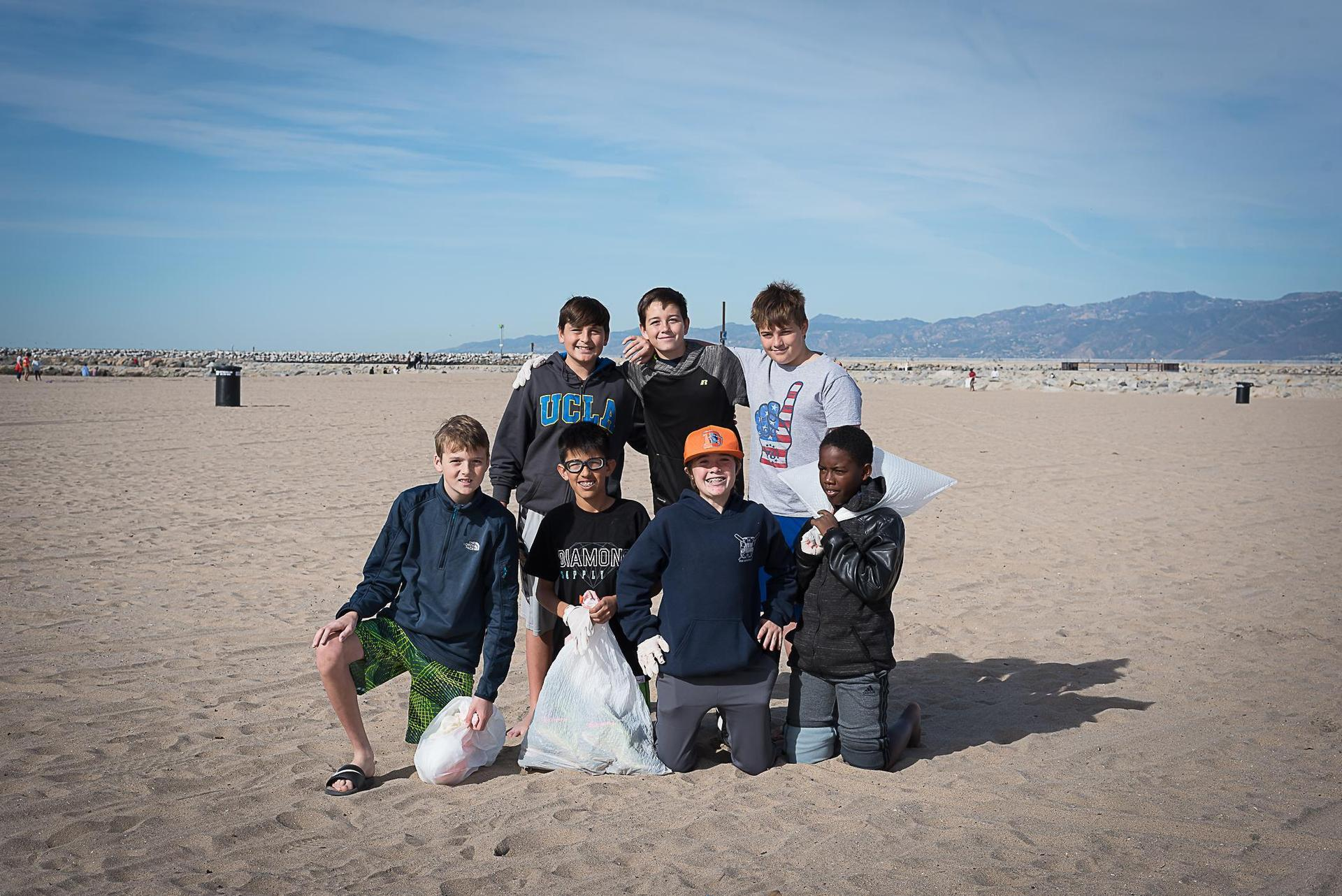 students cleaning a local beach