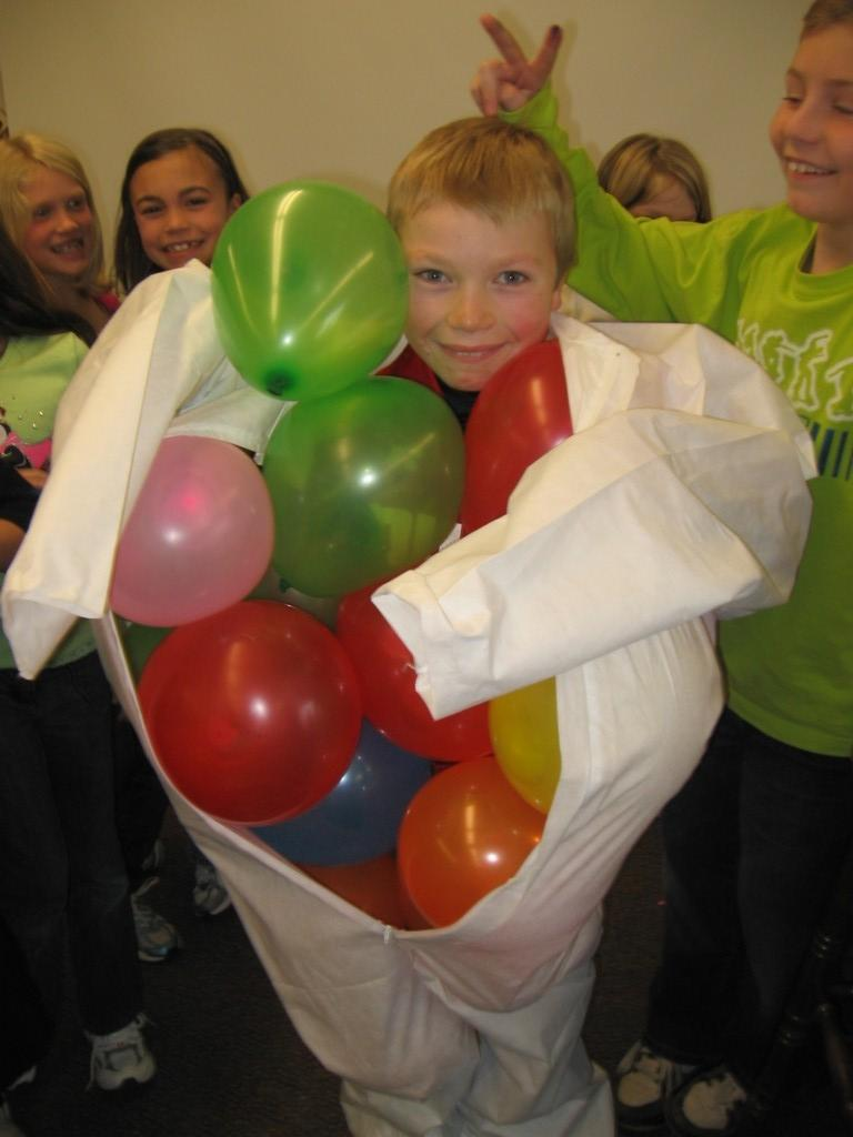 student stuffs balloons in his body suit