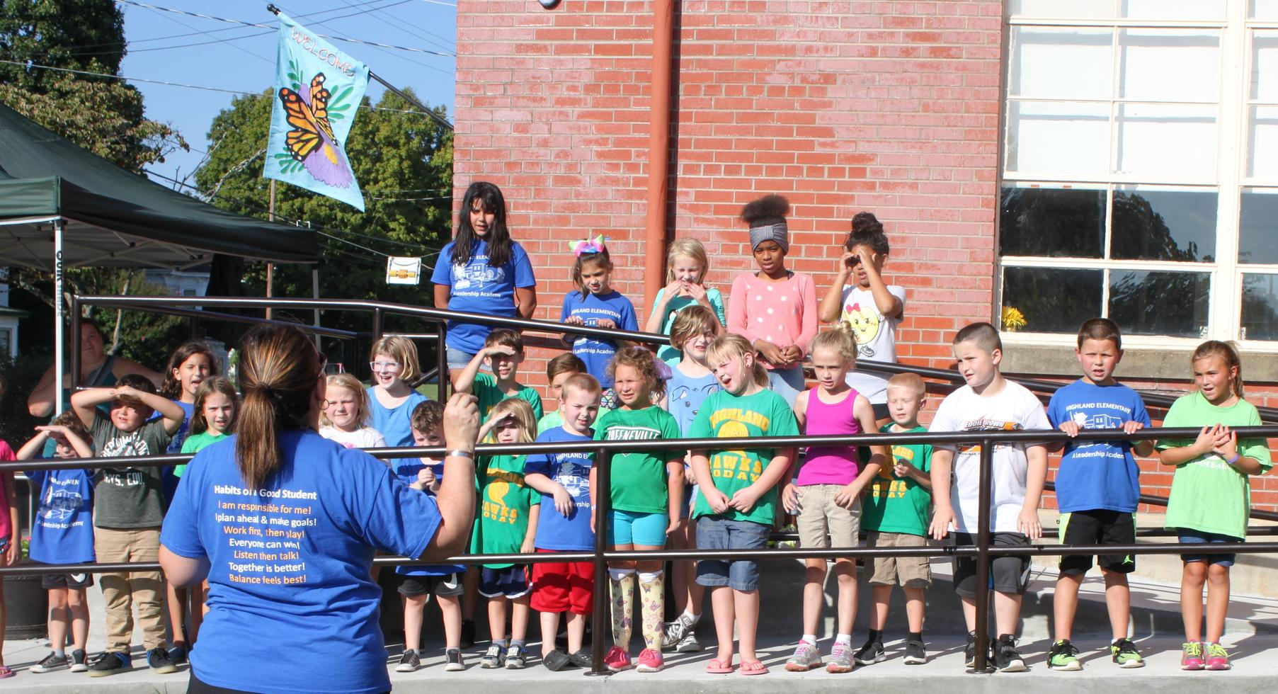 FunFestival for Education: Students sing the national anthem.