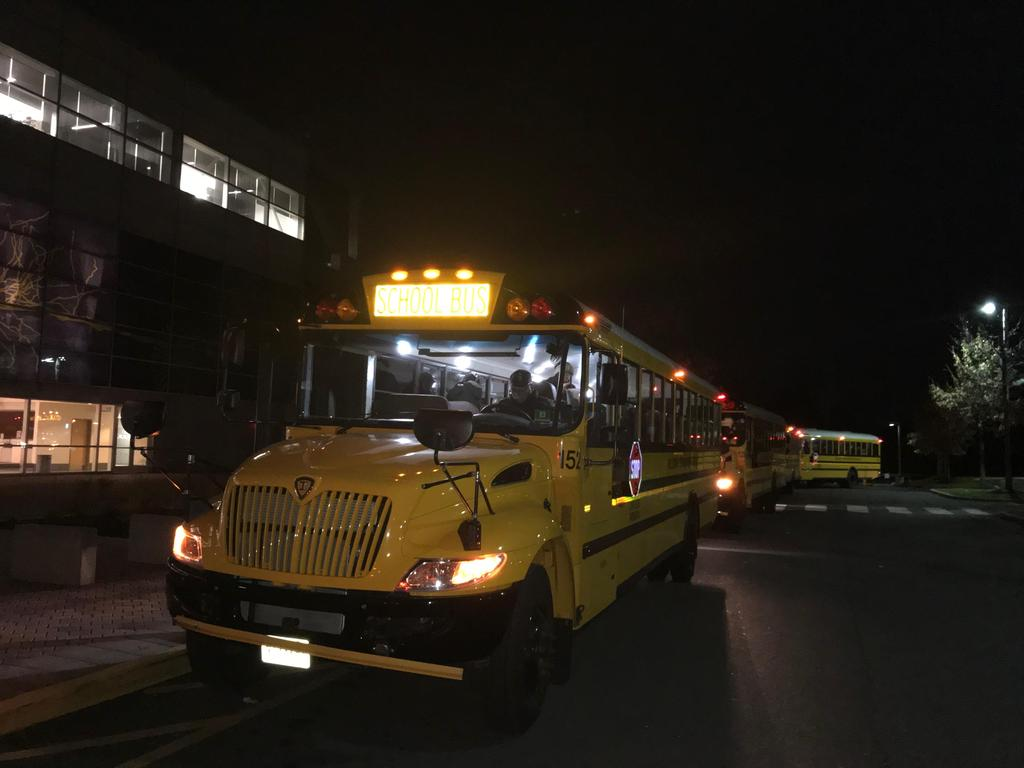 school buses bringing families to the center
