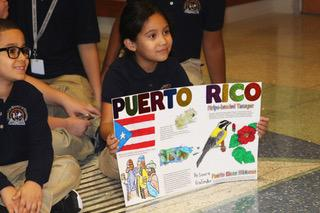 Child holding poster of puerto rico