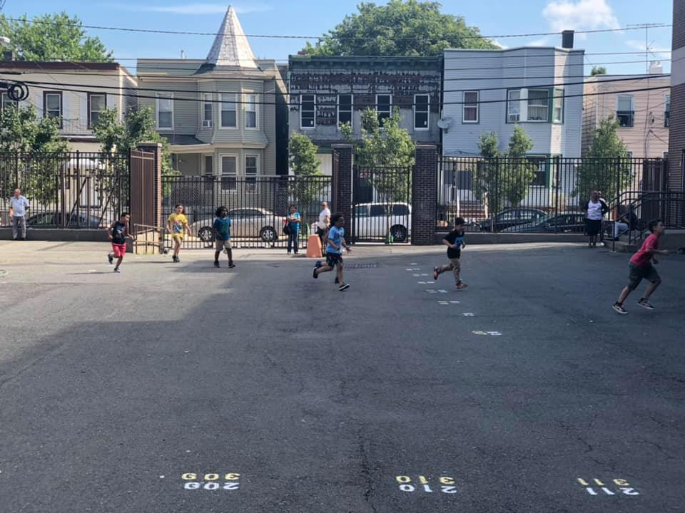 several kids running in the playground