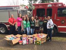 The EJHS Jr. Beta Club partnered with the Eunice Fire Department to deliver toys to families this Christmas during the annual Toys for Tots drive.  Thank you to all students, faculty and staff members for the generous donations.  Accepting donations from the EPD are Steven Fontenot and Chaise Brown.   Sponsors- Lauren Brown, Claudette Castille, and Fran Lemelle Officers (L to R)- Olivia P, Kyra D, Reagan H, Alivia C, and Josi L