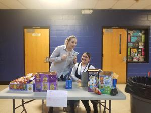 ms. velsaquez and student selling snacks