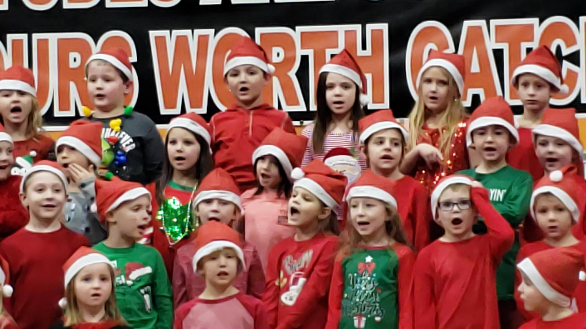 1st Grade Students at Christmas Carol Performance for families