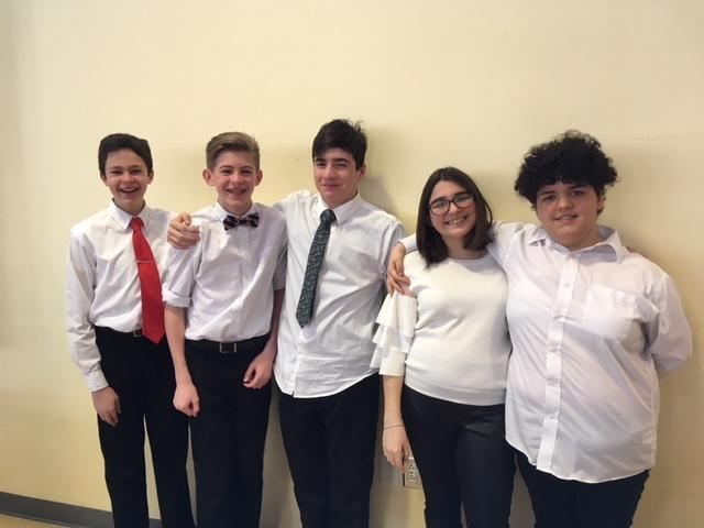 Five students in white shirts