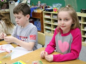 Photo of two Franklin students enjoying Valentine's Day activities.