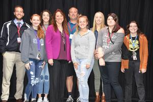 Several East Valley High School seniors and teachers standing in the auditorium with Washington State, Secretary of State, Kim Wyman after her presentation on the importance of voting.