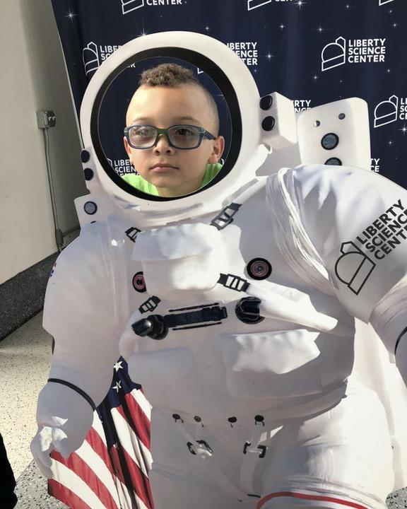 Camper at Liberty Science as an astronaut