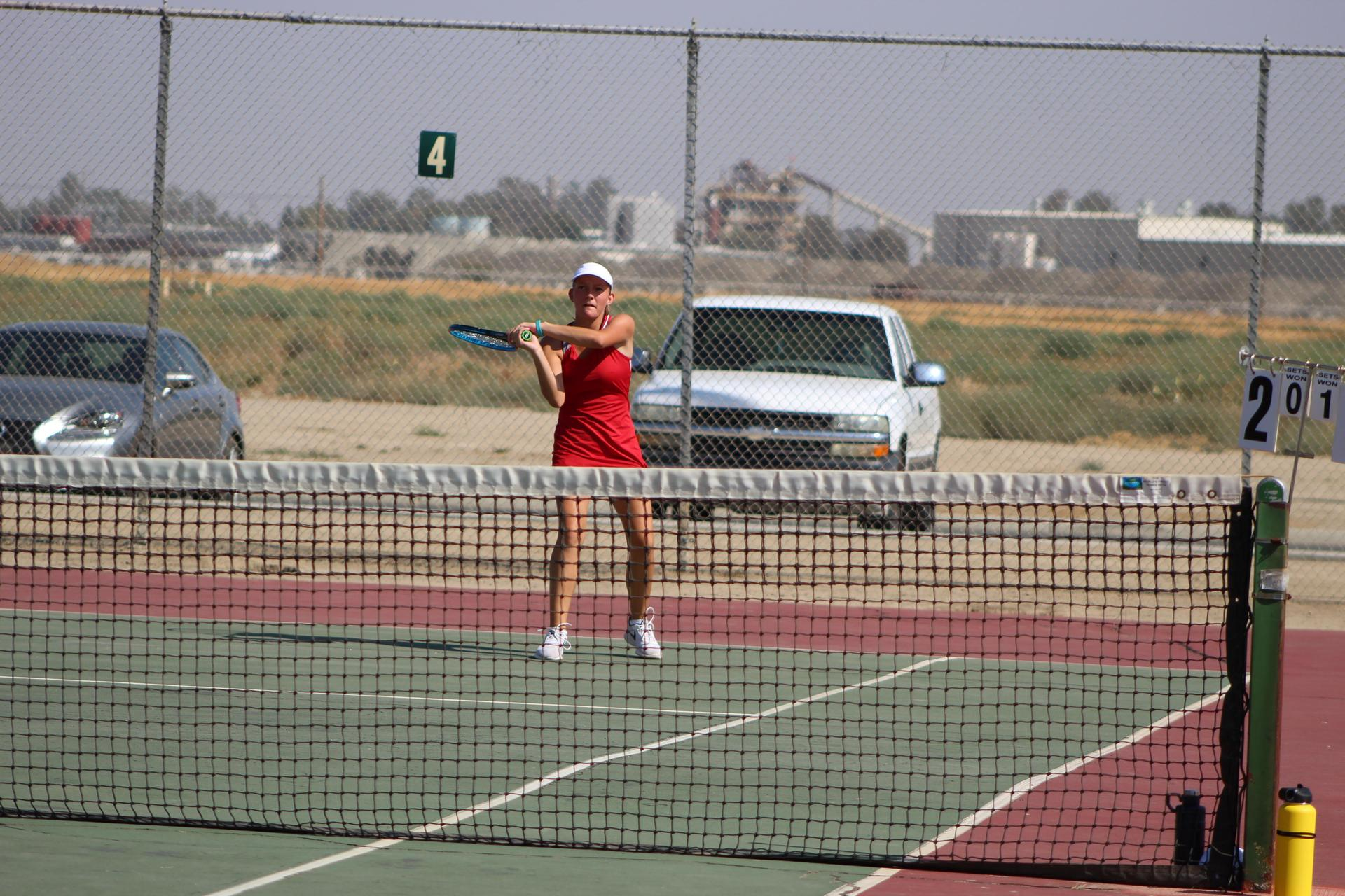 Girls playing tennis vs Madera South