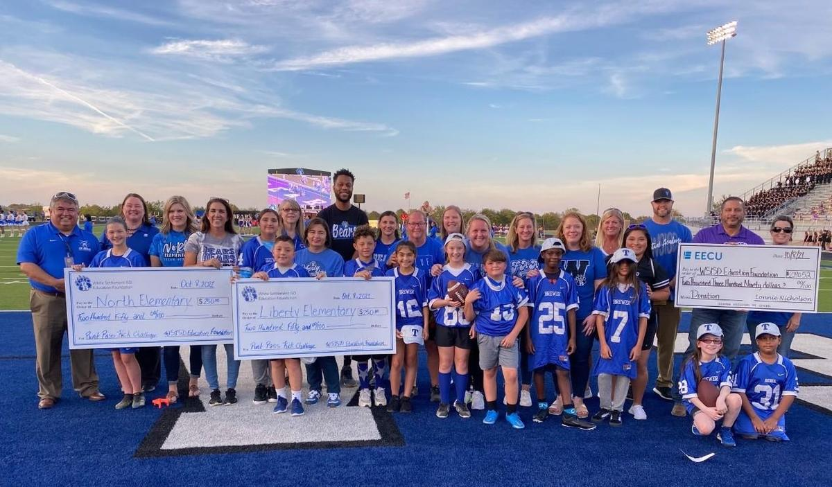 The WSISD Education Foundation sponsored its 7th annual Football Challenge at the Bears' game Friday. Zoe Burns from North Elementary won the girls' category, and David Zurita from Liberty Elementary won the boys' contest.