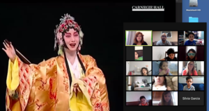 women in traditional Chinese yellow dress singing on Zoom