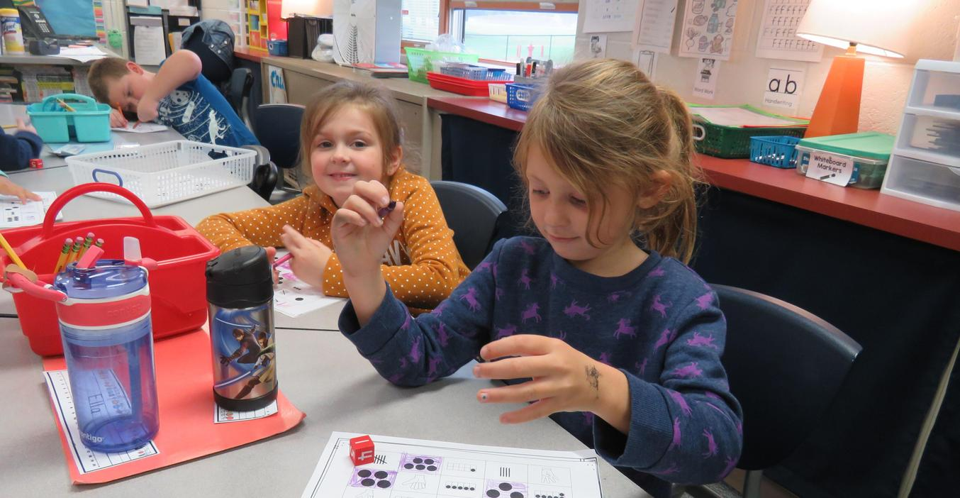 Students learn their numbers by playing games.