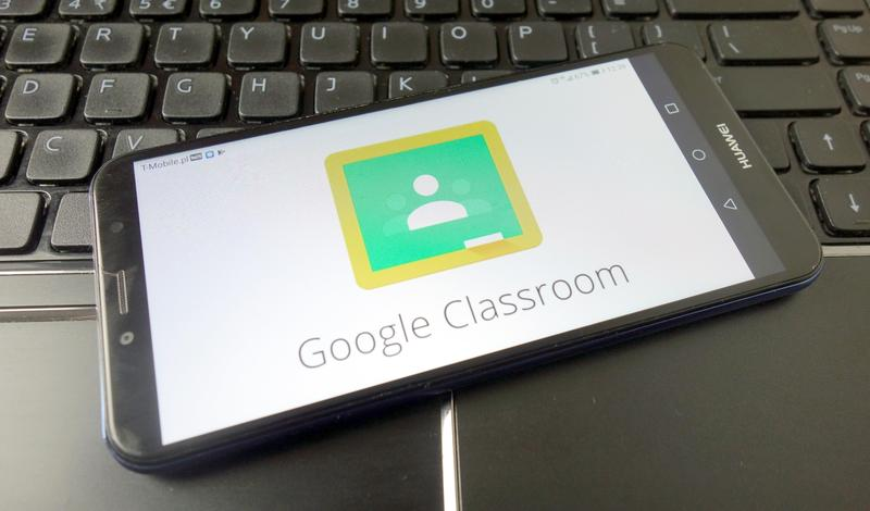 A tablet on top of a keyboard, with the tablet set to the Google Classroom login