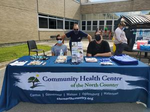 Volunteers at Community Health Center of the North Country Table during Heuvelton Back-to-School Event.