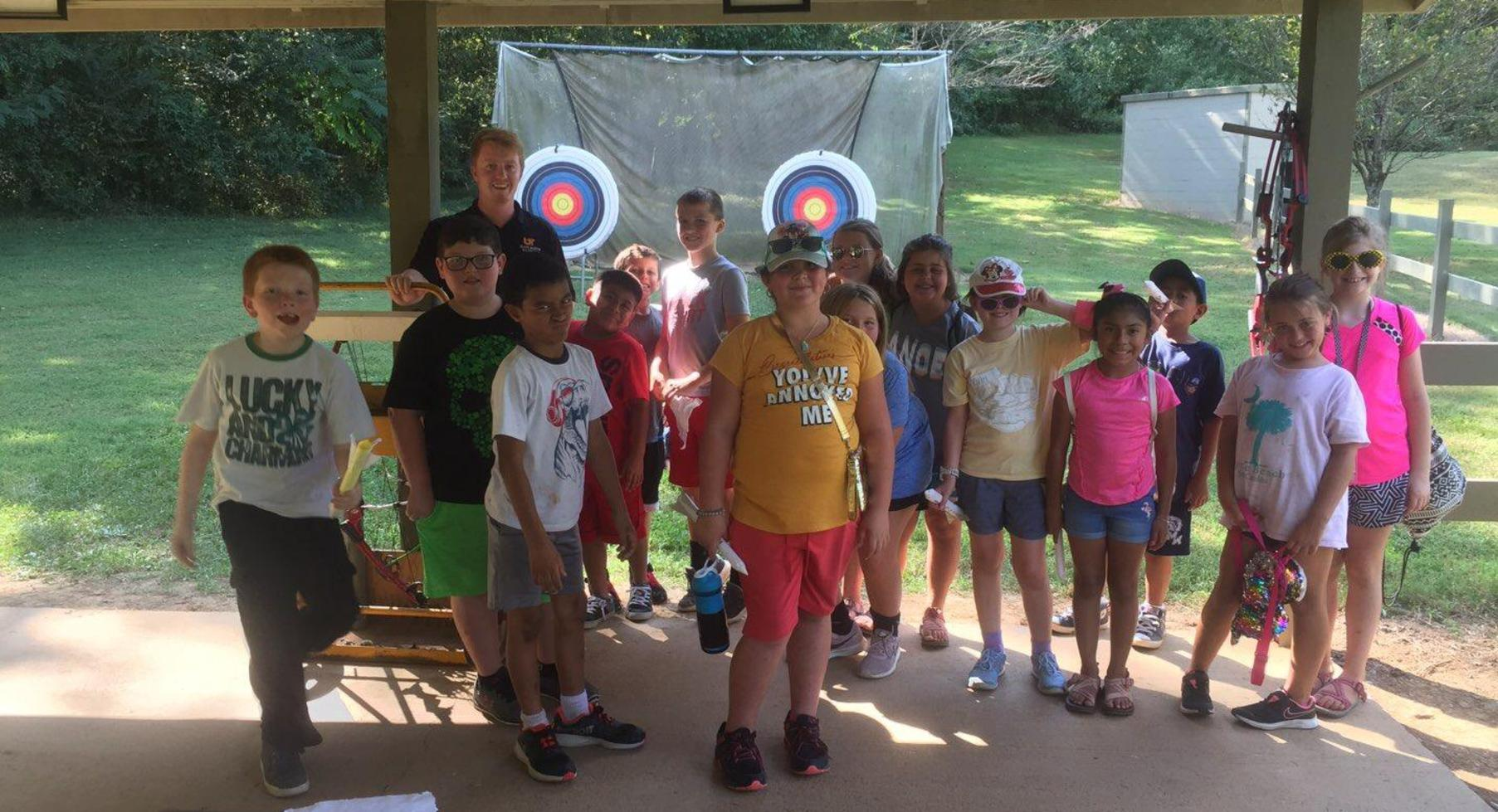 Students at archery target.