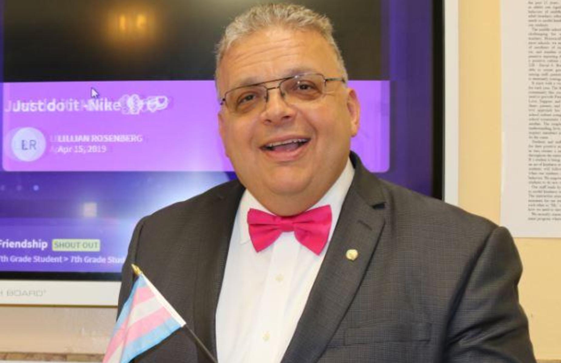 Mr. D'Angelo proudly holding the Transgender flag