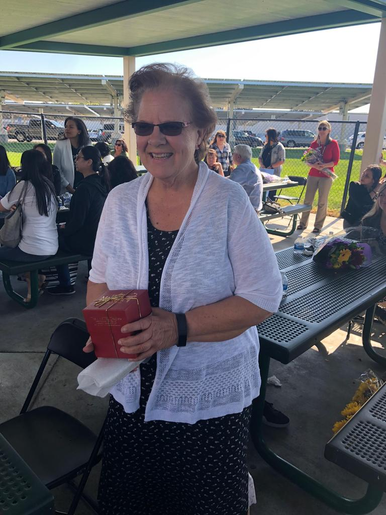 joann johnson receives apple for 40+ years of service