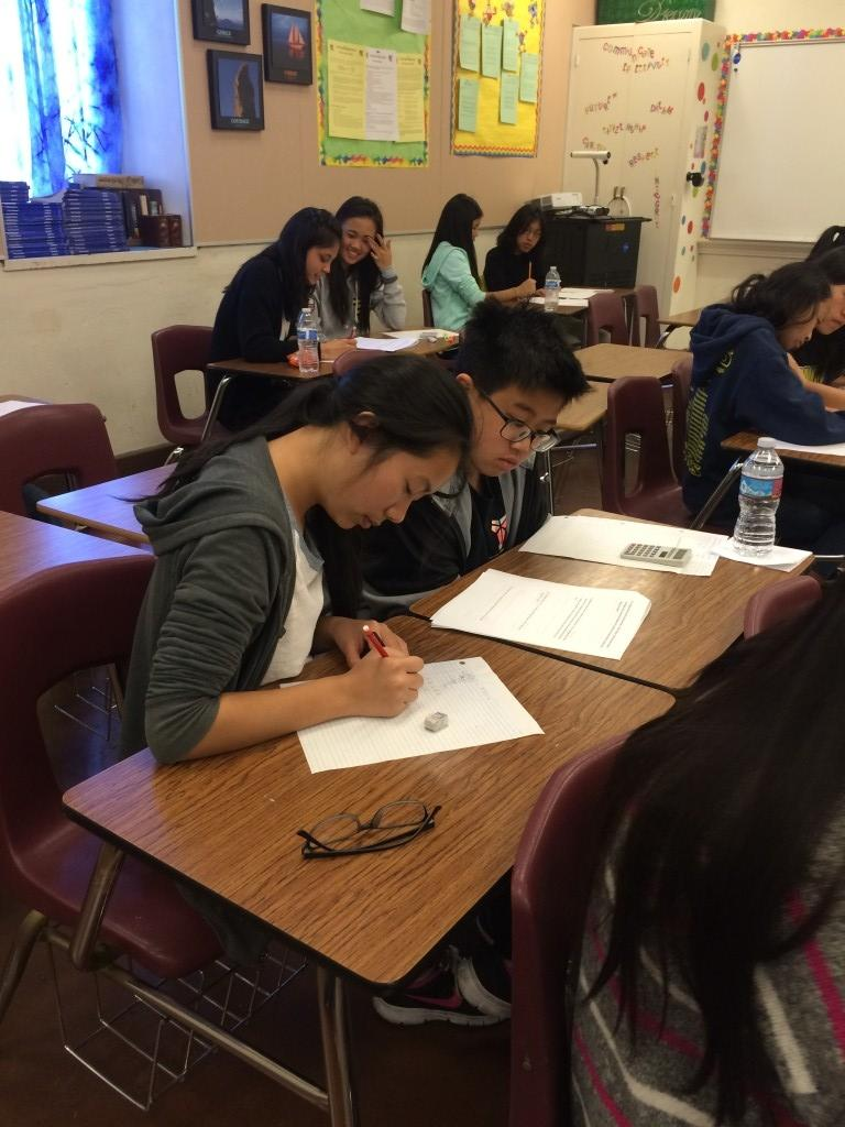 AUSD students work together on math equations.