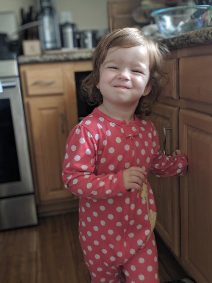 Toddler girl smiling.