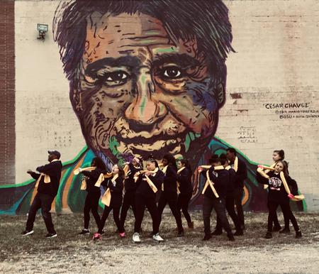 Students of National School Choice dance team dancing in front of a mural