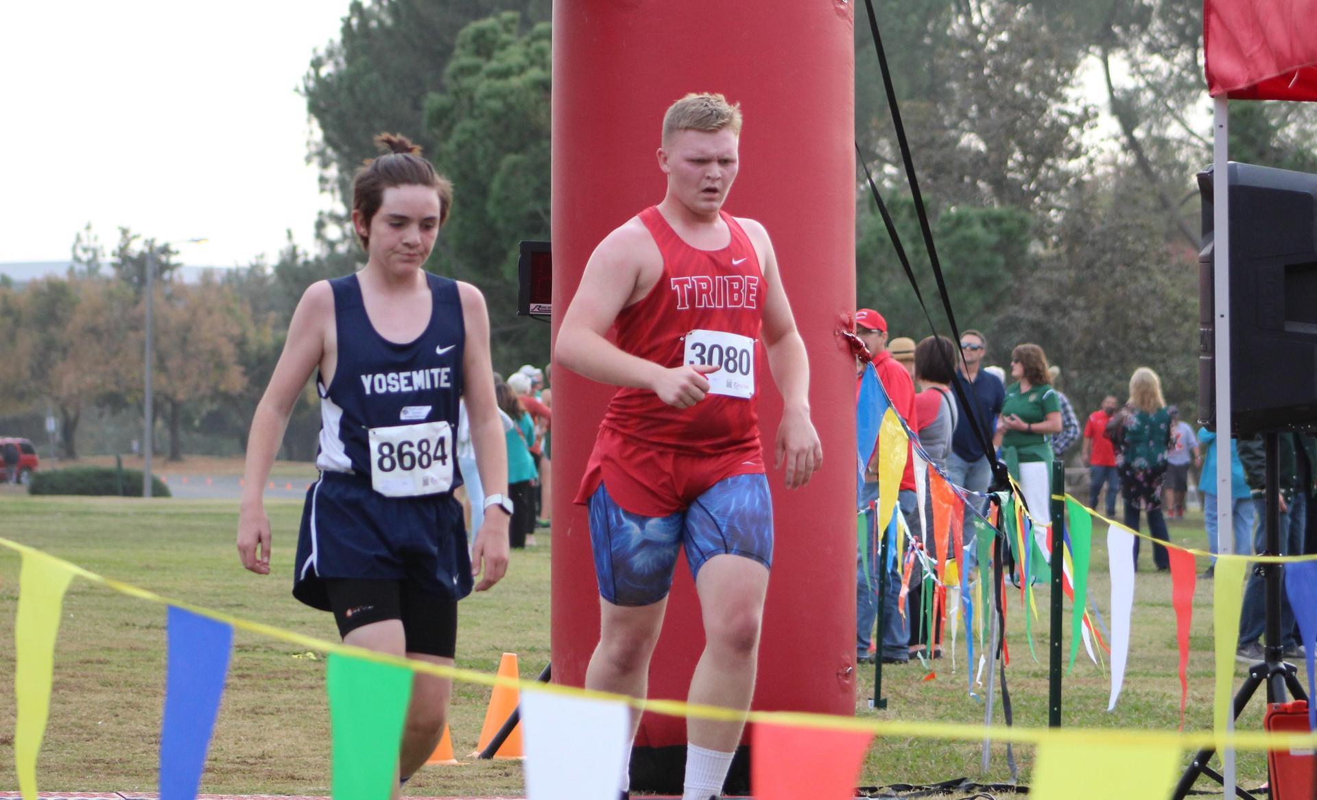Zach Ellison crosses finish line