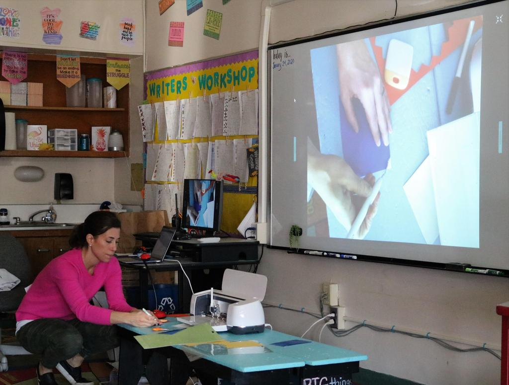 Photo of Tamaques parent teaching students about circuits during STEAM Day.