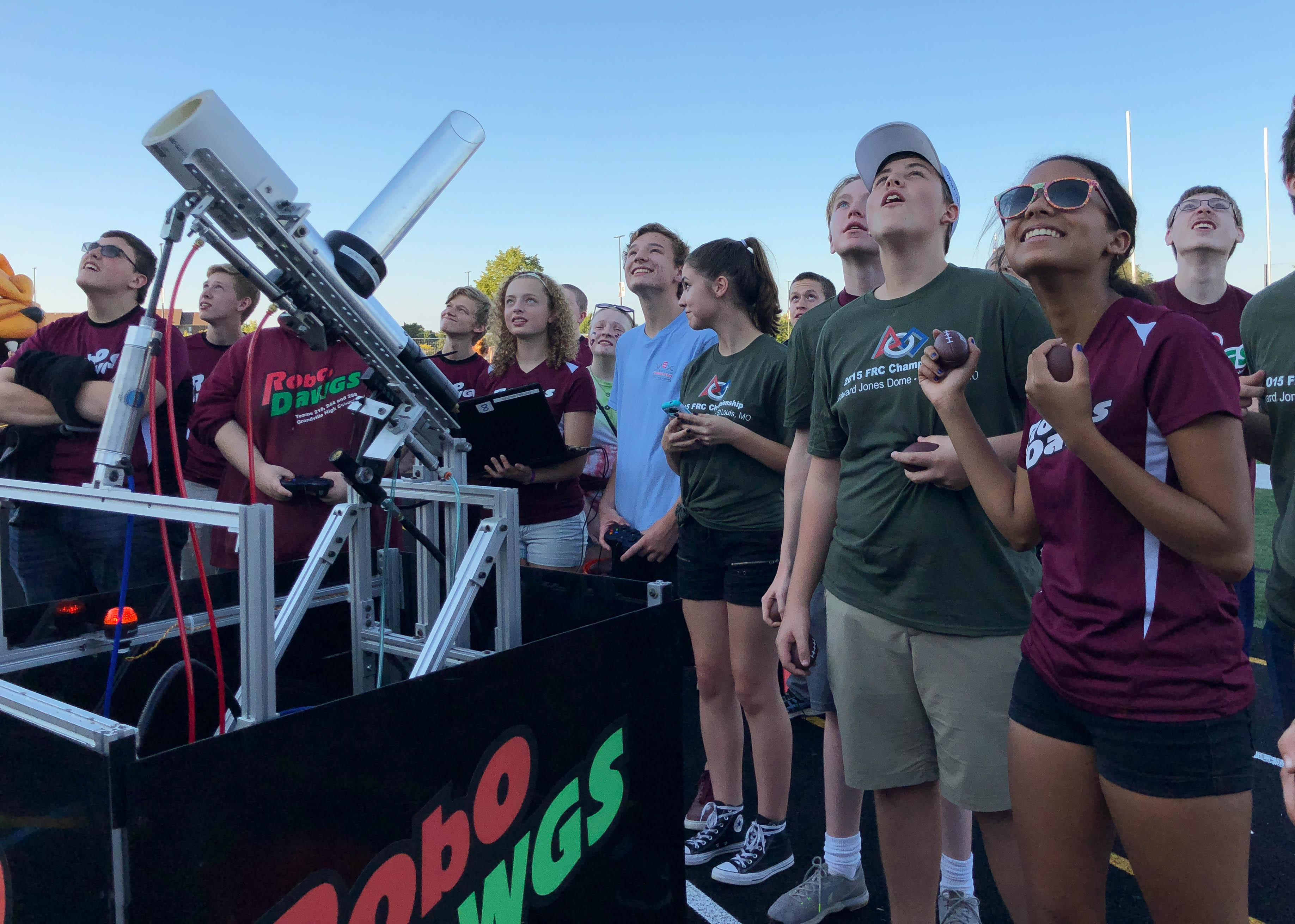 RoboDawgs team shoots t-shirts into stands at game