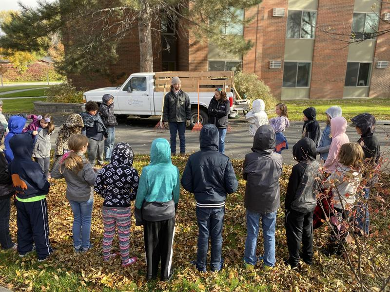 students raking leaves