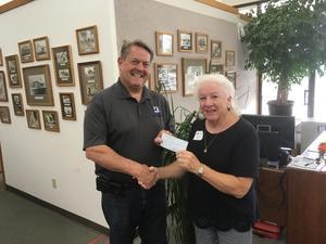 Donation check to Scott Nanik